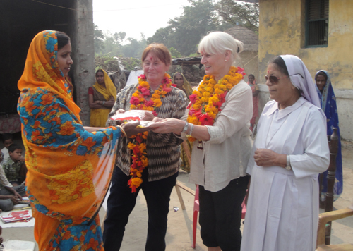 2012: With Sr. Crescence and my cousin Els Schep giving a teacher a gift.